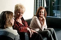 women on sofa